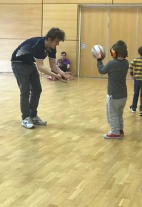 Stephen plays rugby with a child with learning disability