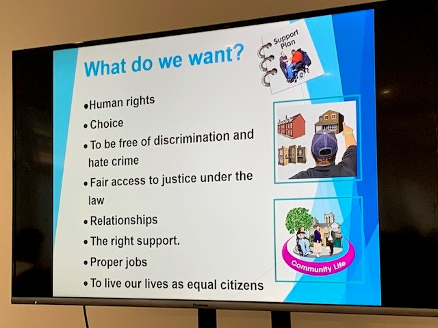A photo of Michelle Steel's slide show, showing a slide with a list of things that people with learning disabilities want, such as 'choice' and 'relationships'.