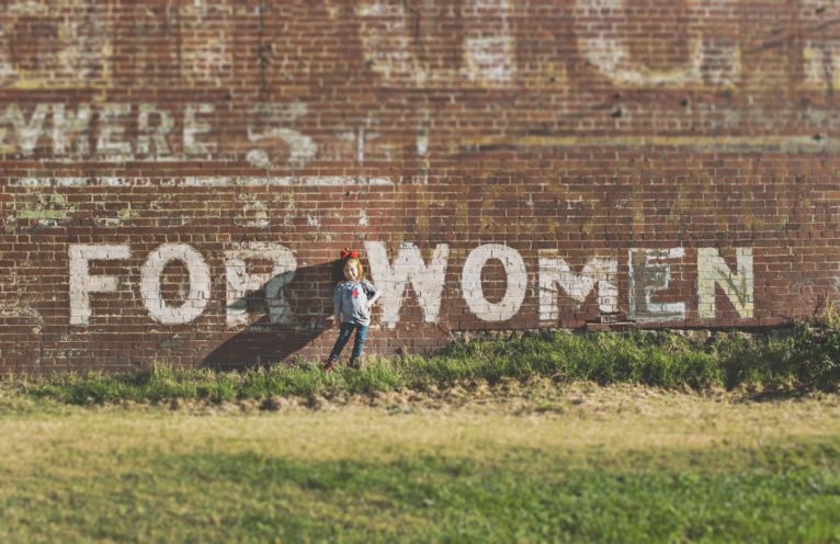 A wall with the text 'For Women' on it