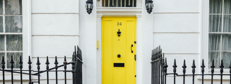 A white house with a yellow door