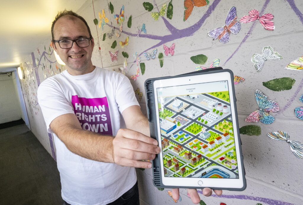 Man holds tablet